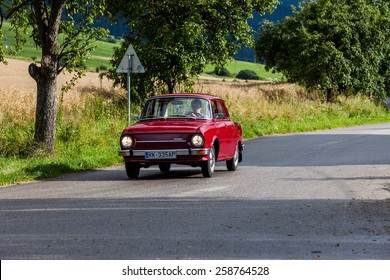LUDROVA, SLOVAKIA - JULY 25: A classic oldtimer car Skoda 100 passing a junction near Ludrova on July 25, 2009. It was the first Skoda car being produced over a million units.