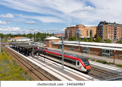 Ludvika, Sweden - June 14, 2019: Regional train, Tag i bergslagen, at station in Ludvika while passengers board the train for further travel in Sweden.