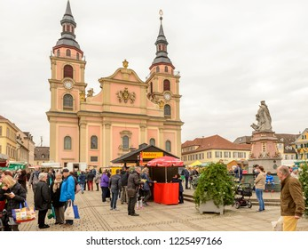 LUDWIGSBURG, GERMANY - NOVEMBER 03: cloudy weather on Saturday market at Baroque City Evangelische church, shot in bright cloudy light on nov 03, 2018 at Ludwigsburg, Germany