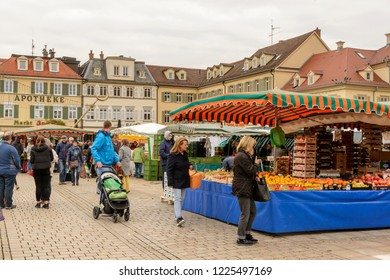 LUDWIGSBURG, GERMANY - NOVEMBER 03: cloudy weather on Saturday market on square sourrounded  by Baroque facades, shot in bright cloudy light on nov 03, 2018 at Ludwigsburg, Germany