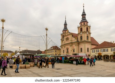 LUDWIGSBURG, GERMANY - NOVEMBER 03: cloudy weather on Saturday market on square in front of Baroque City Evangelische church, shot in bright cloudy light on nov 03, 2018 at Ludwigsburg, Germany