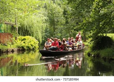 Luebben, Brandenburg, Germany - August 20, 2017: People in a traditional boat trip in Spreewald