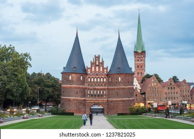 LUEBECK, DE - SEPTEMBER 15, 2017: Holsten Gate (Holstentor), a city gate marking off the western boundary of the old center of Luebeck in Schleswig-Holstein, northern Germany.