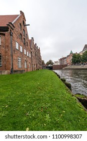 LUEBECK, DE - SEPTEMBER 16, 2017: The Salzspeicher (salt storehouses), six historic brick buildings on the Upper Trave River in Luebeck, Schleswig-Holstein, northern Germany.
