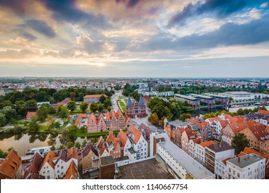 LUEBECK, DE - SEPTEMBER 16, 2017: Holsten Gate (Holstentor), a city gate marking off the western boundary of the old center of Luebeck in Schleswig-Holstein, northern Germany.