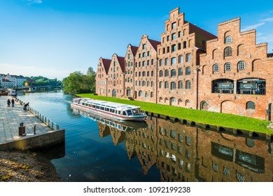 LUEBECK, DE - SEPTEMBER 17, 2017: The Salzspeicher (salt storehouses), six historic brick buildings on the Upper Trave River in Luebeck, Schleswig-Holstein, northern Germany.