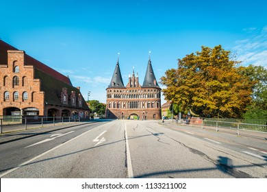 LUEBECK, DE - SEPTEMBER 17, 2017: Holsten Gate (Holstentor), a city gate marking off the western boundary of the old center of Luebeck in Schleswig-Holstein, northern Germany.
