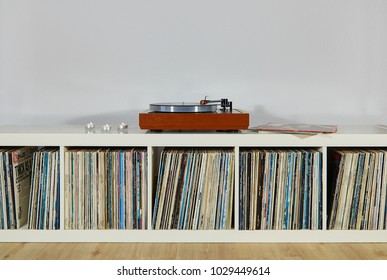 Luebeck, Germany - 02 18 2018: high-quality turntable on a shelf with vinyl records
