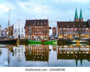 LUEBECK, GERMANY - JAN 2, 2010: beautiful view to the TRAVE and pier in Luebeck with reflections in the harbor.