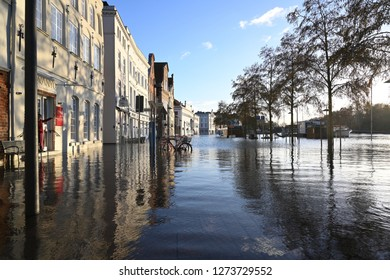 LUEBECK, GERMANY, JANUARY 2, 2019:  Floodwater of the River Trave in the historic old town of Luebeck, Germany, blue sky, copy space