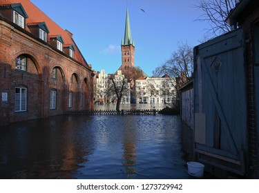 LUEBECK, GERMANY, JANUARY 2, 2019:  High water in the river Trave flooded the historic old town of Luebeck, Germany, blue sky, copy space