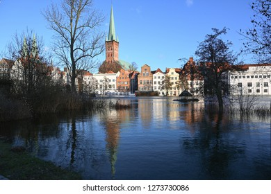 LUEBECK, GERMANY, JANUARY 2, 2019:  High water in the river Trave in the famous tourism town Luebeck, Germany, blue sky, copy space