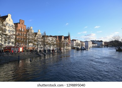 LUEBECK, GERMANY, JANUARY 2, 2019:  River Trave with high water has flooded the historic old town of Luebeck, Germany, blue sky, copy space