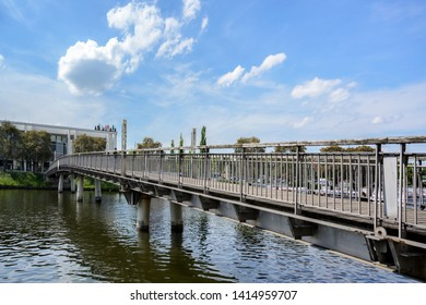 LUEBECK, GERMANY - JUNE 3, 2019: Pedestrian bridge across the river Trave to the MUK, Music and Congress Hall, a modern building  in Luebeck, copy space