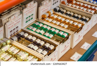 Luebeck, Germany - November 7, 2018: Counter in shop of sweets - famous  Lubeck marzipans. J.G.Niederegger company is  world famous producer of marzipan and sweets; it was founded on 1806.