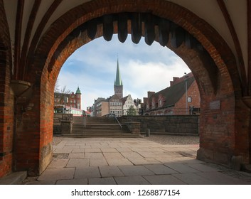 Luebeck, Germany. View of city through arch of famous Holsten gate (Holstentor). UNESCO world heritage.