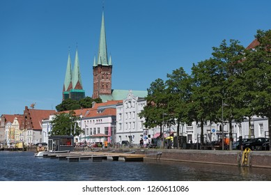 LUEBECK, GERMANY-MAY 25; 2018: St. Peter's Church and st. marys church with traditional houses on the trave river, luebeck, germany