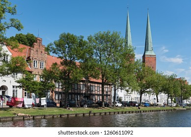 LUEBECK, GERMANY-MAY 25; 2018: st. marys church and traditional houses on the trave, lübeck, germany