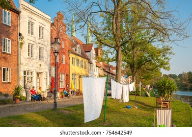 LUEBECK, SCHLESWIG-HOLSTEIN, GERMANY - SEPTEMBER 16, 2014: Historic buildings in the street An der Obertrave in Lubeck at the Baltic Sea