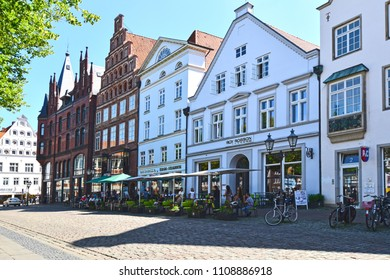 Lueneburg, Germany - June 5, 2018: View to the German medieval town of Lueneburg. You see the facades of bricks and small shops with tourists