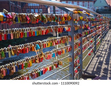 Lueneburg, Germany - June 5, 2018: Countless, colorful love padlocks hanging on a railing at the river Ilmenau in Lueneburg, Germany