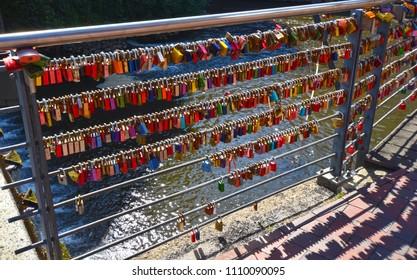 Lueneburg, Germany - June 5, 2018: Countless, colorful love padlocks hanging on a railing at the river Ilmenau in Lueneburg, Germany