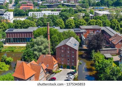 Lueneburg, Germany - June 5, 2018: View from the old water tower of the historic Hanseatic city of Lueneburg, Germany, to an old factory near the river Ilmenau.