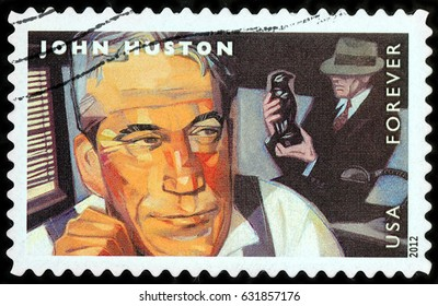 LUGA, RUSSIA - APRIL 26, 2017: A stamp printed by USA shows famous American film director John Marcellus Huston and actor Humphrey Bogart starring in the film The Maltese Falcon, circa 2012