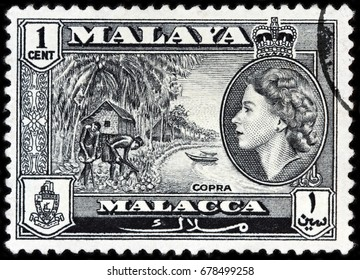 LUGA, RUSSIA - APRIL 26, 2017: A stamp printed by MALAYA shows image portrait of Queen Elizabeth II against beautiful landscape of peninsula in Southeast Asia, circa 1957.