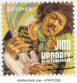 LUGA, RUSSIA - APRIL 26, 2017: A stamp printed by USA shows image portrait of James Marshall Jimi Hendrix - an American rock guitarist, singer, and songwriter, circa 2014