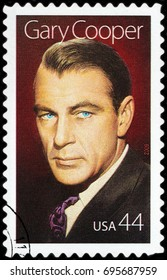 LUGA, RUSSIA - APRIL 26, 2017: A stamp printed by USA shows image portrait of famous American film actor Gary Cooper, circa 2009