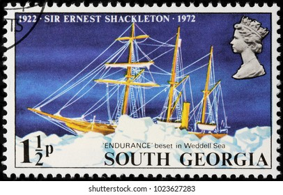 LUGA, RUSSIA - FEBRUARY 08, 2018: A stamp printed by SOUTH GEORGIA shows Sir Ernest Shackleton ship Endurance beset in the pack ice of the Weddell Sea, circa 1972