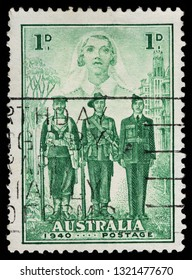 LUGA, RUSSIA - FEBRUARY 13, 2019: A stamp printed by AUSTRALIA shows Sailor, Soldier, Pilot and Nurse, Australias participation in WWII, circa 1940