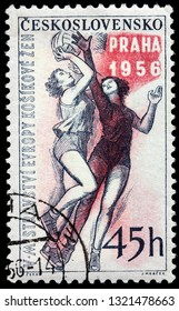 LUGA, RUSSIA - FEBRUARY 13, 2019: A stamp printed by CZECHOSLOVAKIA shows two women basketball players, circa 1956.