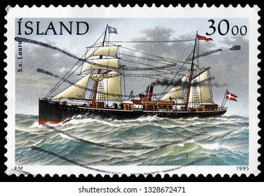 LUGA, RUSSIA - FEBRUARY 13, 2019: A stamp printed by ICELAND shows 1875-built steamship Laura, circa 1995