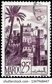 LUGA, RUSSIA - FEBRUARY 13, 2019: A stamp printed by MOROCCO shows beautiful view of Ouarzazate - a city in south-central Morocco, circa 1947