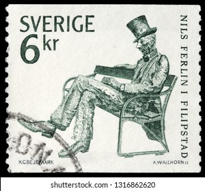 LUGA, RUSSIA - FEBRUARY 17, 2019: A stamp printed by SWEDEN shows statue of famous Swedish poet and lyricist Nils Ferlin sitting on a park bench in Filipstad town, circa 1983