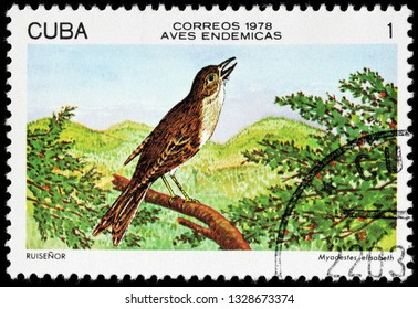 LUGA, RUSSIA - FEBRUARY 17, 2019: A stamp printed by CUBA shows Cuban solitaire, also known as Cuban nightingale - a species of bird in the family Turdidae. It is endemic to Cuba, circa 1978