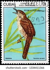 LUGA, RUSSIA - FEBRUARY 17, 2019: A stamp printed by CUBA shows Zapata wren - a medium sized grayish-brown bird that lives in dense shrubs of the Zapata Swamp, Cuba, circa 1977
