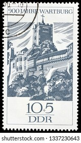 LUGA, RUSSIA - FEBRUARY 17, 2019: A stamp printed by GERMANY (DDR) shows view of New Kemenate and Donjon in Wartburg castle, Thuringia, circa 1966