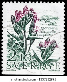 LUGA, RUSSIA - FEBRUARY 17, 2019: A stamp printed by SWEDEN shows Field Gentian (Gentianella campestris) - a herbaceous biennial flowering plant, circa 1987
