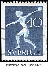LUGA, RUSSIA - FEBRUARY 17, 2019: A stamp printed by SWEDEN shows sportswoman from The National Athletic League, circa 1953