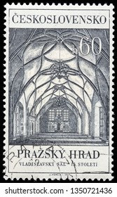 LUGA, RUSSIA - FEBRUARY 17, 2019: A stamp printed by CZECHOSLOVAKIA shows beautiful view of Interior of Hall of King Vladislav in Prague Castle, Czech Republic, circa 1967