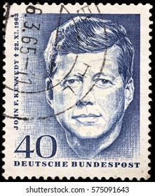 LUGA, RUSSIA - FEBRUARY 7, 2017: A stamp printed by GERMANY shows image portrait of John F. Kennedy, 35th President of USA 1961-1963, circa 1964
