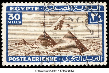 LUGA, RUSSIA - FEBRUARY 7, 2017: A stamp printed by EGYPT shows ancient aircraft flying over the Pyramids of Giza, circa 1933
