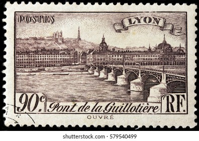 LUGA, RUSSIA - FEBRUARY 7, 2017: A stamp printed by FRANCE shows view of the Bridge Guillotiere in Lyon - city in east-central France, in the Auvergne-Rhone-Alpes region, circa 1939