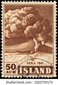 LUGA, RUSSIA - JANUARY 16, 2018: A stamp printed by ICELAND shows Mount Hekla erupting in 1947 in the south of Iceland. Hekla is one of Iceland's most active volcanoes, circa 1948