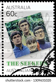 LUGA, RUSSIA - JANUARY 22, 2019:  A stamp printed by AUSTRALIA shows the album cover of an Australian folk-influenced pop quartet The Seekers, circa 2013.