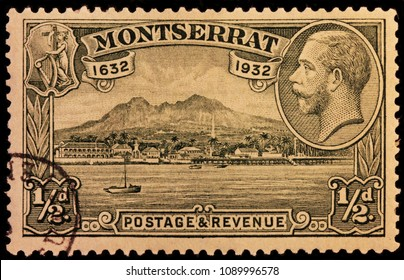 LUGA, RUSSIA - JANUARY 23, 2016: A stamp printed by MONTSERRAT shows image portrait of King George V against beautiful view of New Plymouth harbor, circa 1932.