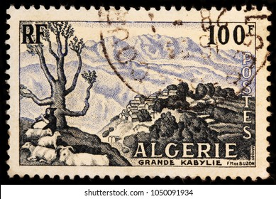 LUGA, RUSSIA - JANUARY 23, 2018: A stamp printed by ALGERIA shows view of Kabylie (Kabylia) - cultural and natural region in northern Algeria. It is part of Tell Atlas mountain range, circa 1955.